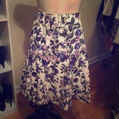 SALE  ANTHROPOLOGIE Purple Floral Skirt Beautiful purples and deep blues set on a white background, this floral print is stunning. The skirt is lined and has a sewn in yoke so it fits smoothly along the hips. Hidden side zipper. 35 Anthropologie Skirts Mini