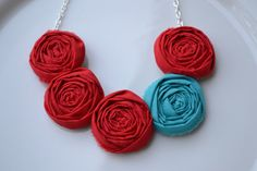 Teal and red fabric rolled rosette necklace
