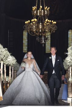 This Bride Married in a Million Dollar Dress Victoria Swarovski Her million-dollar wedding dress, designed by Michael Cinco, featured 500,000 crystals and weighed roughly 100 pounds. And, of course, with a dress like that, Victoria needed a 26-foot long, lace-edged veil to complete her princess look.