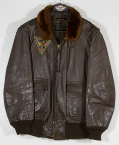 Lot 549: Vietnam Era USN Aircraft Carrier Pilot Leather Jacket; Size 44 zippered jacket with CVW SIX patch on the right front
