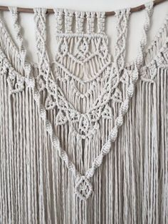 This macrame wall hanging is hand-made by Hanifah in Sydney, Australia and it is made-to-order. It is perfect to hang in your living room or bedroom above your bed. This special piece is made out of a single strand cotton rope giving it a soft look.   Measurement: Length 72cm Height 100cm