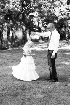 AmyCo photo... This is my fav!! Flower girl and groom/Daddy and daughter photo!