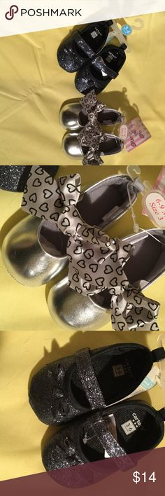 Baby girl shoe bundle of NWT grey size 3 Baby girl shoe bundle of silver with big silver bows detailed with black tiny open heart . The other is a classic Mary Jane style in deep grey with sparkles over the entire shoe and tiny front toe bow details . Both super cute and versatile to go with all your little ones outfits size 3 or 6-9 m and NWT carters and stepping stones  Shoes Baby & Walker