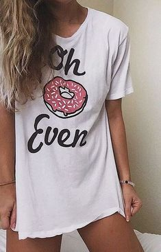 this t-shirt design represents color psychology, typography, and use of shape. donut is used in font to create a meaning. cursive font.