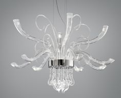 """ELYSEE L18 SUSPENSION - <p style=""""text-align: justify;""""> Elysée evokes the traditional style of a Murano chandelier, but with a modern twist. Composed of translucent, hand-blown glass, its sculptural, LED-illuminated arms and central body set it apart from others in the category. Jewel-like pendants made from hand-crafted glass fall from Elysée's polished steel and chrome-plated metal structure. This striking chandelier is available in two sizes and can be double switched. Companion…"""