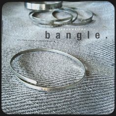 s i e b e n w e l l e n    bangle. sterling-silver, poetry stamped,