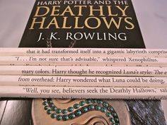 A set of five #2 pencils, wrapped with pages from J.K Rowlings seventh Harry Potter book, Harry Potter and the Deathly Hallows. Each pencil