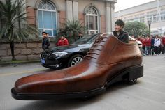 "Shoe Company Steps Up Their Marketing with the Giant Leather Shoe Car · ""Made from real bull hides (about five of them) this giant leather shoe car can travel up to 20 miles per hour and carry two people. While that's pretty impressive for a shoe, I wonder if the company plans to create a faster version modeled after a sneaker."""