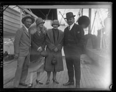 1920s fashion and ocean travel. Race car drivers, Earl Cooper and Barney Oldfield with their wives on deck of ship, circa 1926.