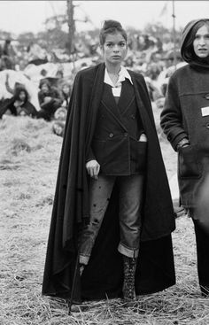 Bianca Jagger - Love the whole combo, cape over jacket with super casual jeans.