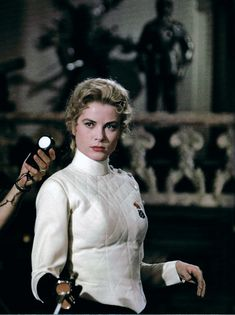 """Grace Kelly in """"The Swan"""", 1956. Is this real fencing gear or just a movie costume?"""