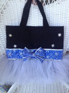 Great for the holiday. This tutu bag beasures 13 by 13 by 4 inches. We can add any name to the bag. We do have matching silver thread. This bag is great for the holidays. Dress in style.  Free personalization... add a name or a saying