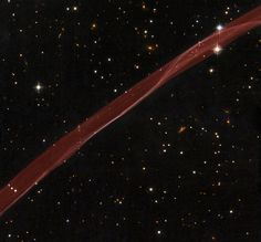 A delicate ribbon of gas floats eerily in our galaxy. A contrail from an alien spaceship? A jet from a black-hole? Actually this image, taken by NASA's Hubble Space Telescope, is a thin section of a supernova remnant caused by a stellar explosion that occurred more than 1,000 years ago.