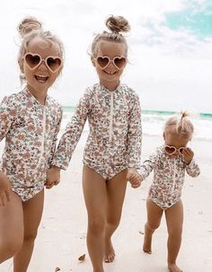 Gorgeous floral print long sleeve rashsuit with front zipper. PLEASE NOTE: SWIMWEAR IS FINAL SALE Baby Swimwear, Baby Swimsuit, Trendy Kids, Stylish Kids, Clothing Labels, Beach Girls, Mood, Kids Outfits, Baby Outfits