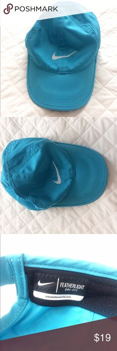 Nike Blue Dry Fit Featherlight Hat Nike blue featherlight Dry Fit hat. In excellent condition and only worn once for my half marathon. Small scuff shown in picture. Nike Accessories Hats