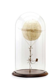 'The Unicycle', cardboard, trace paper mounted on wooden base with hand-blown glass dome, x cm Gravity's Rainbow, Sculpture Art, Sculptures, Paper Structure, Melbourne Art, Jar Art, Plastic Model Kits, Glass Domes, Painting For Kids