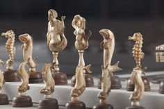 """sea-life-chess-set-9916, Italian Carved Ivory and Hardwood """"Sea Life"""" Chess Set, 19th century Italy Ivory, hardwood, and leather Collection of the Family of Jacqueline Piatigorsky Photo by Michael DeFilippo"""