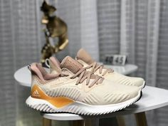 hot sale online d8eae 1b85f Cheap Priced Adidas AlphaBounce HPC AMS 3M Gold White Shoe