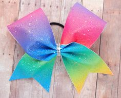 Hey, I found this really awesome Cheer Bow. https://www.etsy.com/listing/477213095/cheer-bow-rainbow-cheer-bow-christmas