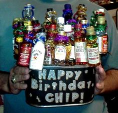 The perfect bouquet for any man's birthday!    Items: Container, Kabob Sticks, Pipe Cleaners, Styrofoam, and airplane bottles of his favorite liquor!    Instructions:   1. Cut out Styrofoam (need 2-3 layers).  2. Place layers in container until snug.  3. Cut Kabob sticks at different lengths to achieve the highrise effect.  4. Wrap 4 pipe cleaners around neck of airplane bottle and kabob stick.  5. Shove kabob stick down into container until desired height.    6. Add tinsle and sign! Man Birthday, Birthday Gifts, Happy Birthday, Party Time, Party Party, Party Ideas, Gift Ideas, Liquor Gift Baskets, Pipe Cleaners