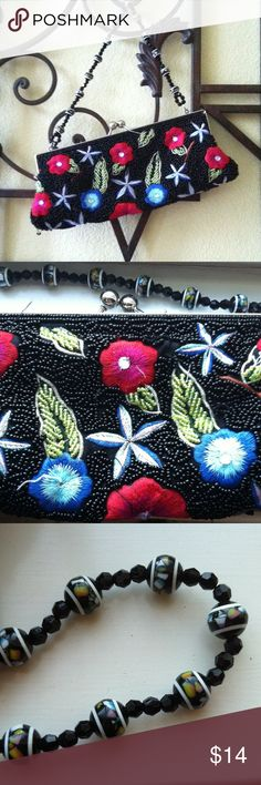 Floral Beaded Clutch This little black clutch is exquisite! It is beaded on both sides and has a black satin-like interior with a small pocket. The handle has glass beads which can be worn tucked on or out. This bag has been very loved on and is still in very good shape! Bags Clutches & Wristlets
