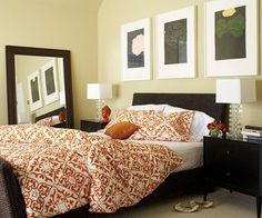 Create a cozy space with a nature-inspired pattern and a color scheme of autumn hues. See more stunning real-life bedrooms: http://www.bhg.com/rooms/bedroom/master-bedroom/25-of-our-favorite-real-life-bedrooms-/?socsrc=bhgpin081912fallorangebedspread#page=16