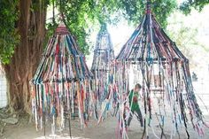 If I had a large space either indoors or outdoors, I would create these with the children (imagine collecting old ties, clothes, ribbons). I love the idea that children can play inside the tents or with the tent itself. It has the appearance of a private space inside yet it is see-thru. All year, children can add to it... Just beautiful.