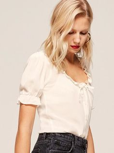 Ruffles, not like chips. This is a button front top with a ruffle edged neckline and a ruffle edged, puffed sleeve.