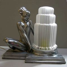 Frankart Fish Face Nymph Art Deco table lamp in polished aluminum