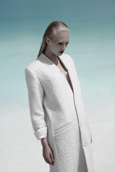 Photographer: Niklas Hoejlund www.niklashoejlund.com  fashion photography female sun light water white coat blonde hair