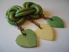 BAKELITE LOVEKNOT HEARTS Brooch by CollectibleKeepers on Etsy, $95.00