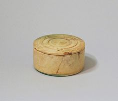 Bone pyxis (box with lid) Period:Early Imperial, Julio-Claudian Date:1st half of 1st century A.D. Culture:Roman Medium:Bone Dimensions:Overall (box): 15/16 x 2 1/16 in. (2.5 x 5.3 cm); diameter of lid 2 1/8 in. (5.4 cm) Classifications:Miscellaneous-Bone, Ivory Credit Line:Gift of Carlos A. Picón, in memory of Lydia Mannara, 2004 Accession Number:2004.507a, b