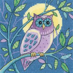 Embrace the beauty of British Wildlife with this Owl cross stitch kit from Heritage Crafts. The finished design features a purple owl perching on a branch in the glow of the moon.