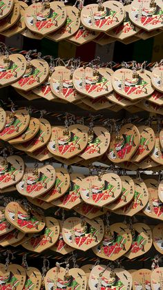Ema 絵馬 : small wooden plaques on which Shinto worshippers write their prayers or wishes in Japan.
