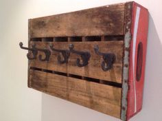 Antique Coca Cola Crate with Antique Cast Iron Wall Hooks, you can DIY! Old Coke Crates, Coke Crate Ideas, Old Wooden Crates, Wine Crates, Vintage Crates, Antique Wooden Boxes, Vintage Coke, Coca Cola Kitchen, Coca Cola Decor