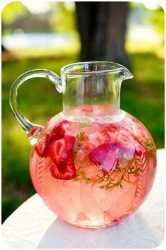 This strawberry, mint infused lemon water looks perfect for a spring tea party!