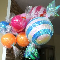 An easy way to create a sweet, colorful display: Wrap bouncy balls in cellophane  to look like pieces of candy