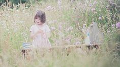 Iris Grace painting in a field.