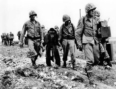 MAY 25 1945 Okinawan civilians try to leave the battlefield - See more at: http://ww2today.com/Marines escort an elderly Okinawan civilian from battle, Battle of Okinawa, June 1945,