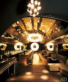 An awesome bar with some cool lighting.  Is that mirror on the ceiling?  that could help with lighting...