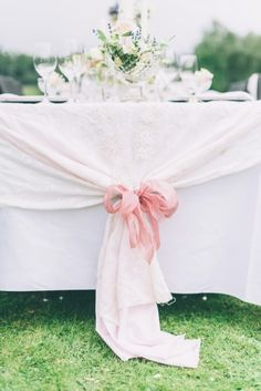 A bow for the tablecloth: http://www.stylemepretty.com/collection/2322/