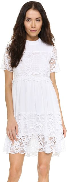 KENDALL + KYLIE Lace Babydoll Dress - A charming KENDALL + KYLIE dress with sheer lace trim. High neckline. Short sleeves. Hidden back zip. Lined.      Fabric: Lightweight weave / lace.     Shell: 100% polyester.     Trim: 90% nylon/10% cotton.