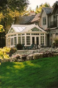 Traditional Exterior of Home with Raised beds, Transom window, Pathway, Sun room, French doors