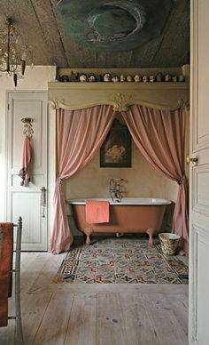 A bathtub in a secret nook. The perfect hideaway after a stressful day. Just not pink. A nice seafoam green.