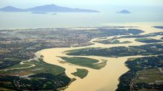 View of Hoi An and Cham Island while flying into Danang Airport. Flooded river from rainy season.