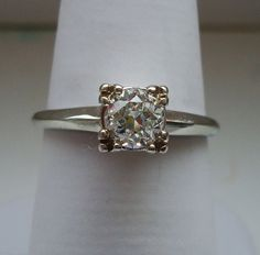 LOVE vintage!  Vintage diamond solitaire Old European Cut 0.60 carats 14K white gold engagement ring. £1,270.00, via Etsy.