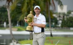 Padraig Harrington of Ireland poses with the trophy after winning during round four of the Indonesia Open at Damai Indah Golf, Pantai Indah Kapuk Course on December 2014 in Jakarta, Indonesia. Padraig Harrington, December 7, Bunker, Jakarta, Ireland, Golf, Poses, Figure Poses, Irish