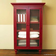 Re-use the black TV armoire for storage in the playroom and paint it this color?
