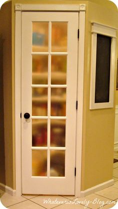 Lighted corner pantry with white French door, frosted glass. Plus a DIY framed chalkboard!