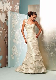 Offering high quality fabrics, attention to detail, style, elegance and simplicity, Paloma Blanca has been a favorite in the bridal industry since 1937.  PB-008